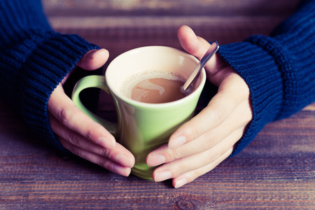 Coffee cup and hand