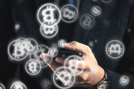 businessman operating a bit coin with a smartphone
