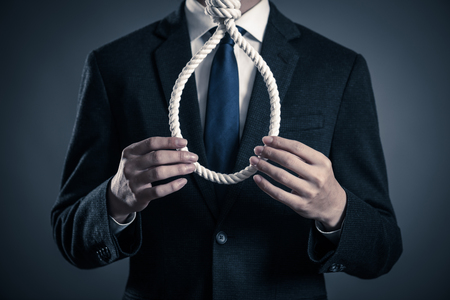 Concept of stressed businessman holding a noose