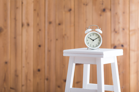 Alarm clock placed on the stool