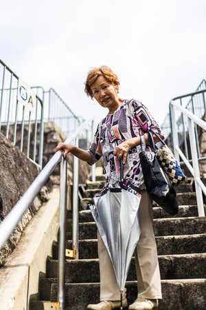 The Elderly and Stairs Stock Photo