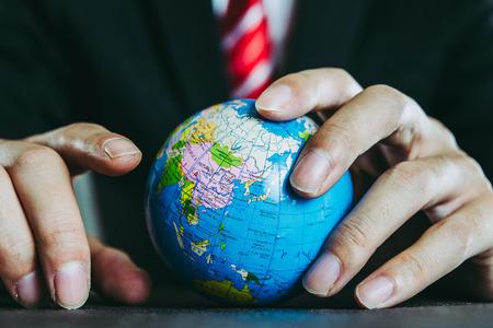 globe and a businessman