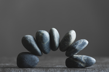 Stacked stones and gray background