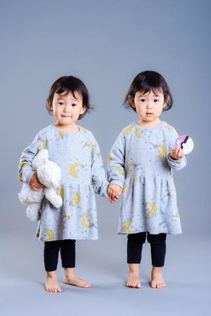 Cute twins children studio portrait