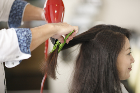 Asian women and hairdressers Фото со стока