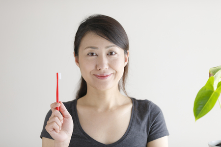 Asian women with toothbrush Stock Photo