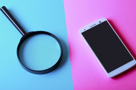 Smartphone and magnifying glass 写真素材