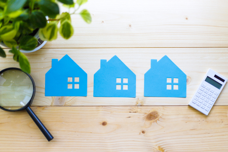 Houses and magnifying glass