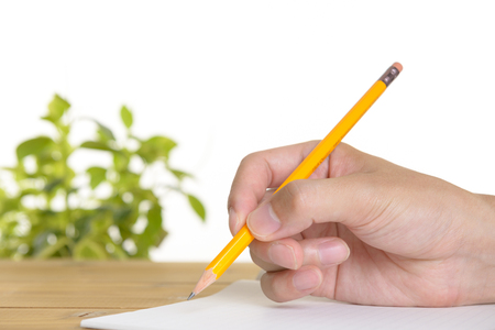 Pencil and hands of men