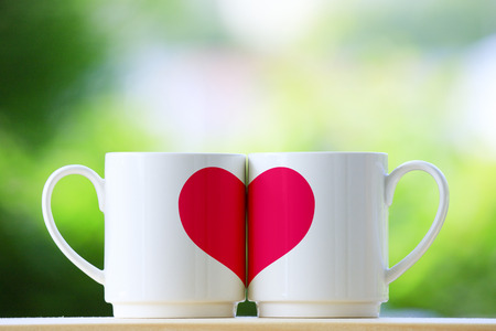 Two mugs and a heart
