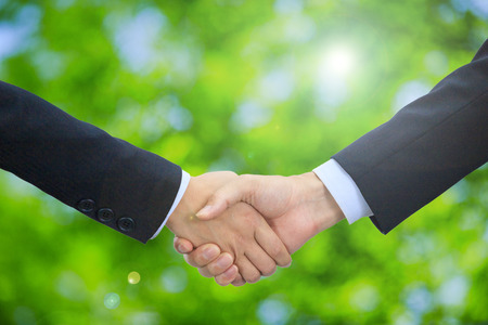 Shake hands with the natural background