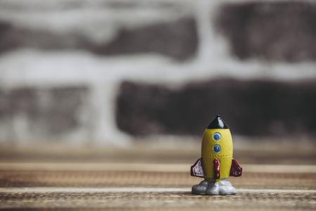 Brick background and toy rocket 版權商用圖片