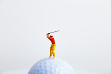 Miniature figures and golf balls 写真素材