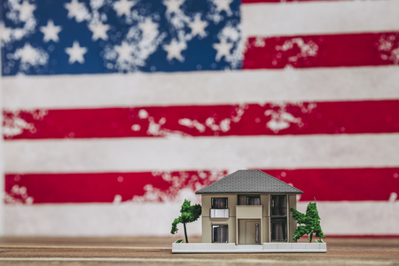 American flag and housing model