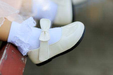 A girl wearing a beautiful white shoes 版權商用圖片