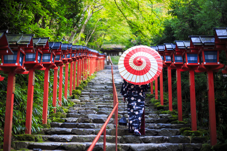 Asian woman wearing japanese kimono at Kifune Shrine in Kyoto, Japan 写真素材
