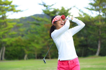 Asian woman golf beginner