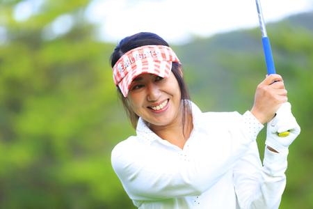 Asian woman golf beginner