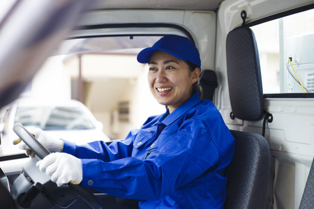 Asian women and light trucks 写真素材