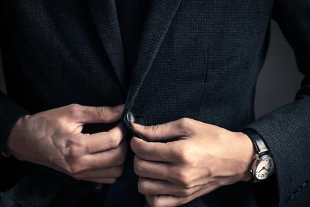 Men closing buttons