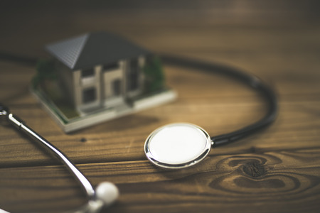 Stethoscope and house 写真素材 - 115161869