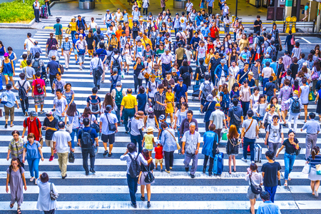 Osaka, Japan - 12 August 2018 - People walking crosswalk at Umeda in Osaka,Japan.