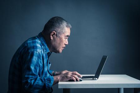 Laptops and Asian senior men 写真素材