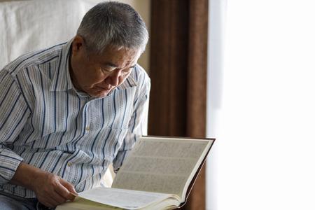 senior male reading book 写真素材