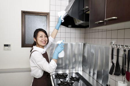 Japanese women cleaning kitchen ventilators Archivio Fotografico