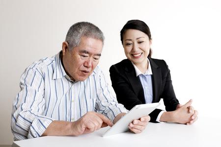 Elderly men and tablet