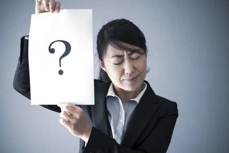 Question mark and businesswoman Фото со стока