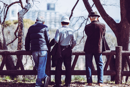 Asian elderly man and back Фото со стока
