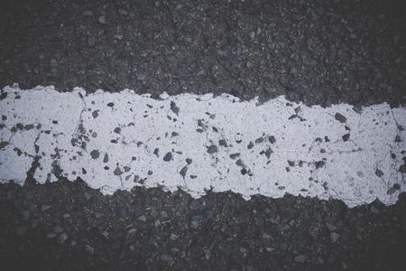 Asphalt and white lines