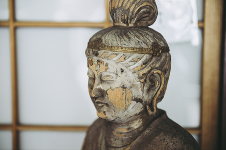 Buddha statue and face