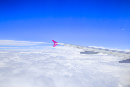 Airplane feathers and clouds