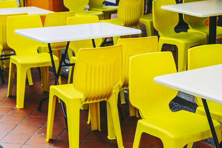 A cafe with yellow chairs
