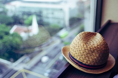Straw hat and window Stok Fotoğraf