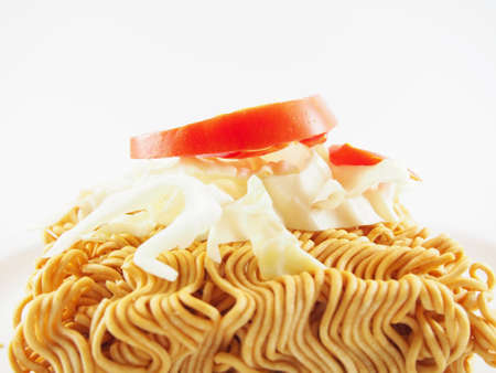 monosodium glutamate: Fresh Tomato and Cabbage is put down on Dried Instant Noodles.