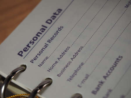 fill in: Opened notebook on personal data page, fill in data, name, address, telephone number Stock Photo