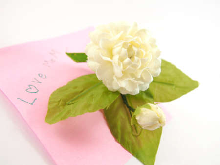 mother 's day: Handmade white jasmin flower, telling love mom with note paper card, Mother s Day, Thai tradition, isolated on write background