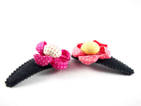 hair clip: Handmade flowers, made from colorful fabric, sunflower shape on black hair clip, modern hair accessory, isolated on white background Stock Photo