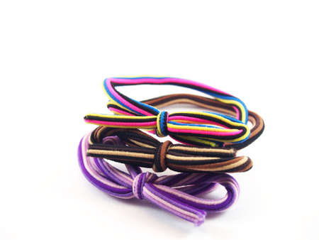 bundling: Colorful ring binders, designed ribbons, modern fashion accessory for lady Stock Photo