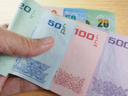 earn money: Taking banknotes in hand, saving and earn money, reward of the year