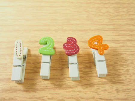 four in one: Wooden paper clips, colorful handmade as number, one, two, three, four Stock Photo