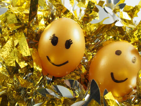 happy couple: Couple of easter eggs with drawing happy smiling, on golden tuft, easter festival Stock Photo