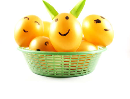 Plastic Easter Eggs On Green Basket Decorated Light Rabbit Ears With Happy Face