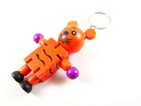 key ring: Orange kitty doll with key ring, handmade wood, isolated on white background