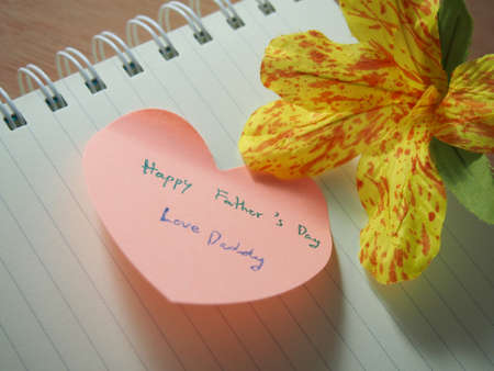father s day: Happy father s day, love daddy, handwriting on  with heart shape, opened notebook with handmade flower