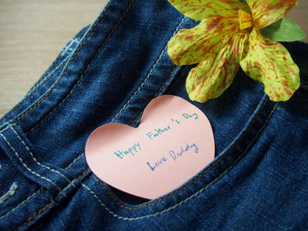 father s day: Short note on sticky paper with heart shape, happy father s day on jeans with handmade flower