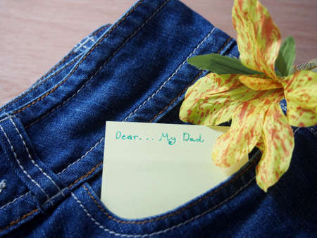 dear: Dear my dad, short note on sticky paper in jean pants bag, decorated with handmade flower